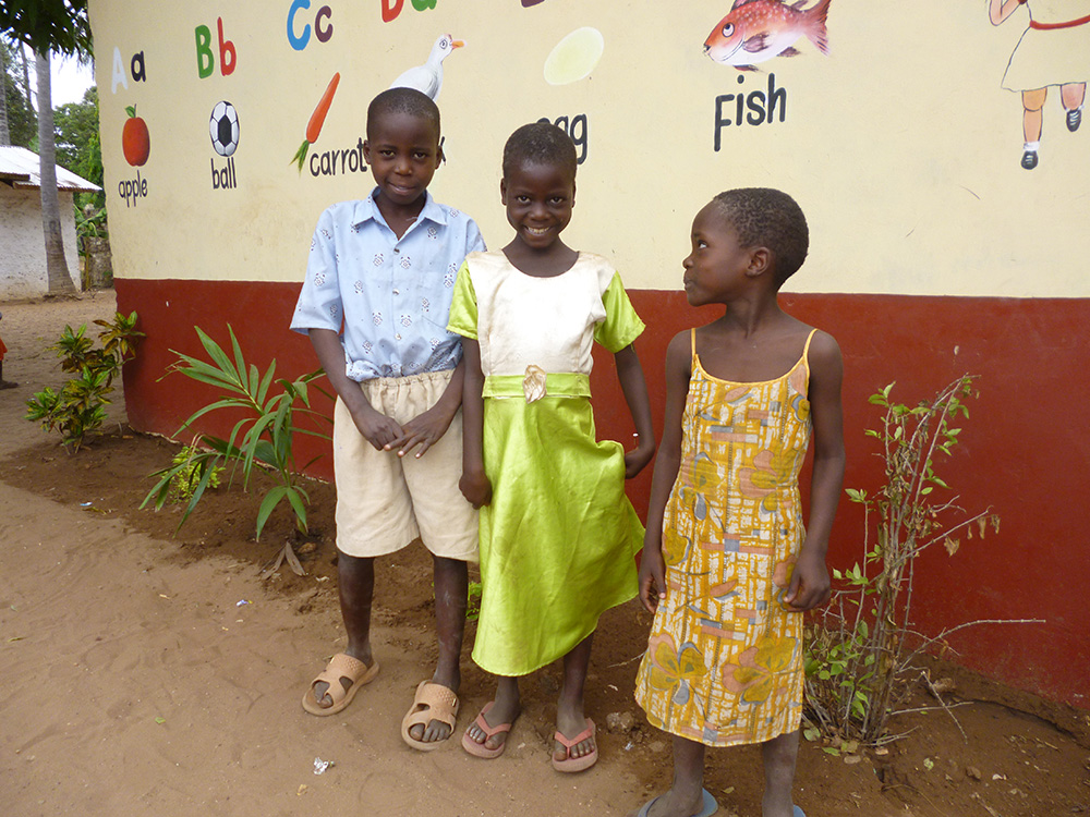 These three young children were made orphans in December 2012. They will live in the school dormitory when it is finished in August 2013